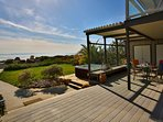 Oceanfront deck with partial glass enclosure