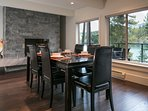 Dining area with fireplace and views of the lake