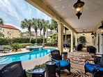 Relax Poolside in the outdoor living/seating area