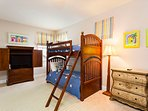 Upstairs bedroom 4 features 2 x Twin bunk beds. 1 also has a lower Full bed and a pull-out Trundle bed