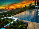 The Tryall Club's expansive great house pool with Caribbean Sea and horizon views at sunset
