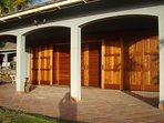 Hand crafted hard wood sliding doors offer privacy, and an ability to be opened to the ocean views.