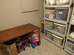 Toys and games for people of all ages and extra towels in storage room, lower level