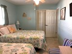 The guest bedroom features a large closet for guest's use.