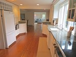 The updated kitchen has granite counters and is fully equipped