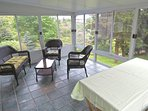 The 3 season room functions as a screened porch in the summer