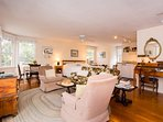 The large studio style room includes a living area, dining table...