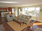 The comfortable living room has plenty of seating and offers a flat screen TV