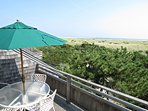Step outside for the best views at the property! The elevated views of the dunes and beach are incomparable.