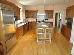 The kitchen is top-of-line with granite counters, stainless high-end appliances and two dishwashers