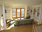 At the top of the stairs there is a lounge area with views of Pleasant Bay; a perfect place to get lost in a book