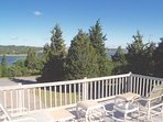Commanding, elevated views of scenic Town Cove from the second level deck. There's plenty of comfy outdoor furniture ...