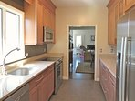 Brand new stainless appliances and granite counters complete this fully outfitted kitchen