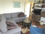 Here's the den off the dining area with a new sectional couch. This room also features a new flat screen TV