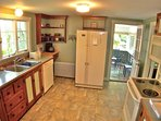The good sized kitchen has everything you'll need, including a dishwasher and microwave.