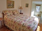 Master bedroom suite with a queen size bed occupies the most recently renovated eastern wing of the home, which has a...