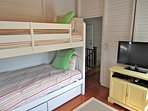 Another bedroom, this one with bright, playful bunk beds and one of several flat screen TVs in the house.
