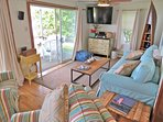 Interior space and decor will delight you.  Note the large flat screen TV.  The cottage now has window a.c. units as...