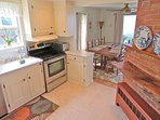The kitchen flows into the dining area then out to the porch and stunning view