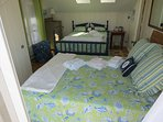 This second upper level bedroom has two queens . . .