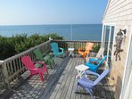 Sweeping beach and bay views from the west deck of this ideally situated family beach house.  Five bedrooms offer ...