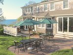 Patio off the main deck has two cafe tables with umbrellas.  The gas grill lives here, too, just to the right out of...