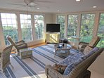 The large, handsome sun room with its Bay view is the interior's centerpiece.
