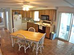 Fully equipped kitchen walks out to sunroom.
