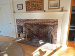 Huge fireplace in kitchen area is a vestige of the original house on the property.