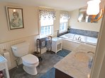 Full bath, upper level has a jetted tub plus separate step-in glass wall shower.
