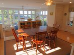 The bright dining area seats up to eight.