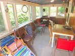 Here's the porch, a good place for morning coffee or evening card games and puzzles.