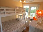 And this one with a full size double under and regular bunk bed over. Note the sliders out to the upper level deck with...