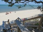 This perfect, private neighborhood beach is less than a one minute walk from the home.