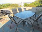 Patio table invites summer time outdoor dining with sweeping water views. Patio furniture has been updated since that...