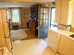 From the kitchen, you walk into the very open main dining and living area of the home