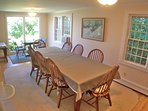 Oversized dining table occupies a portion of the main level's appealing open living space.