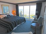 Second level, master bedroom with king size bed.  Those sliders lead to the balcony and striking views of the beach and...
