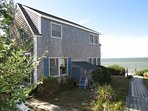 Nestled into the dunes of East Brewster, this two-story three-bedroom cottage is directly on one of the best private...
