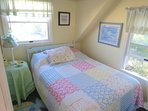 Third BR has this comfy full size double and a cheery decor.