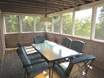 The screened porch is another great place to gather and enjoy a sultry summer evening.  Limited Bay view here as well.