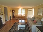 Large dining table occupies one end of the open living space on the main level.