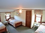 Upper level BR has three twin beds and room to spare
