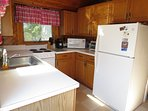 Fully equipped kitchen is ready with all the modern conveniences, except a dishwasher.
