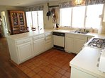 The kitchen is bright, open and fully equipped.
