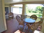 The deck features new wicker outdoor furniture