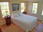 Next door, this Queen bedroom has views of the pool and lawn
