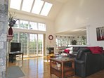 Vaulted ceilings create a light filled spacious room