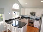 The superb kitchen also has vaulted ceilings with granite counters and Viking stainless appliances
