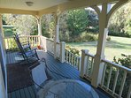The relaxing farmers porch is just off the kitchen and overlooks idyllic Cape tidal marsh and the bay in the distance